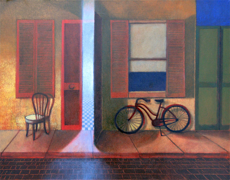 A red bike in a blue alley